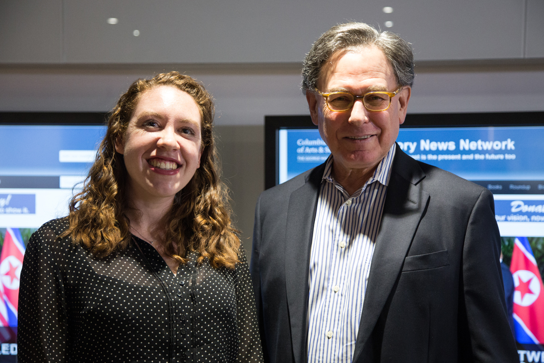 HNN Editor-in-Chief Kyla Sommers, BA '13, PhD '19, and author Sidney Blumenthal stand together smiling
